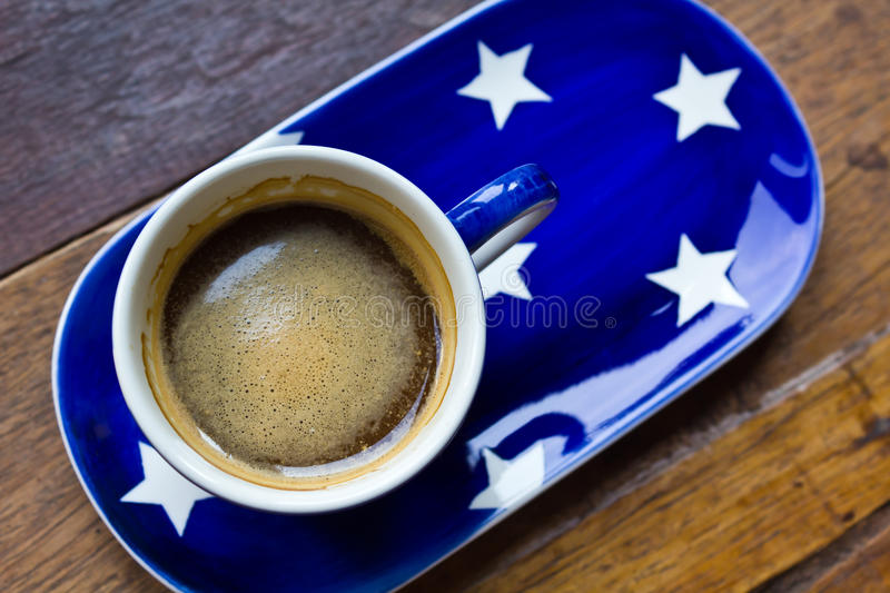 Cup of coffee. And saucer on a wooden floor stock photos