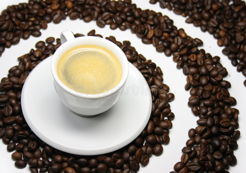 Cup of coffee. With coffee beans on white background royalty free stock photography