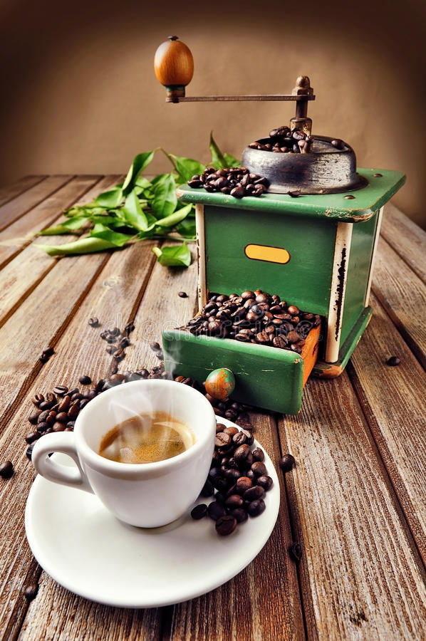 Cup of coffee. A hot cup of coffee with coffee-grinder stock photos