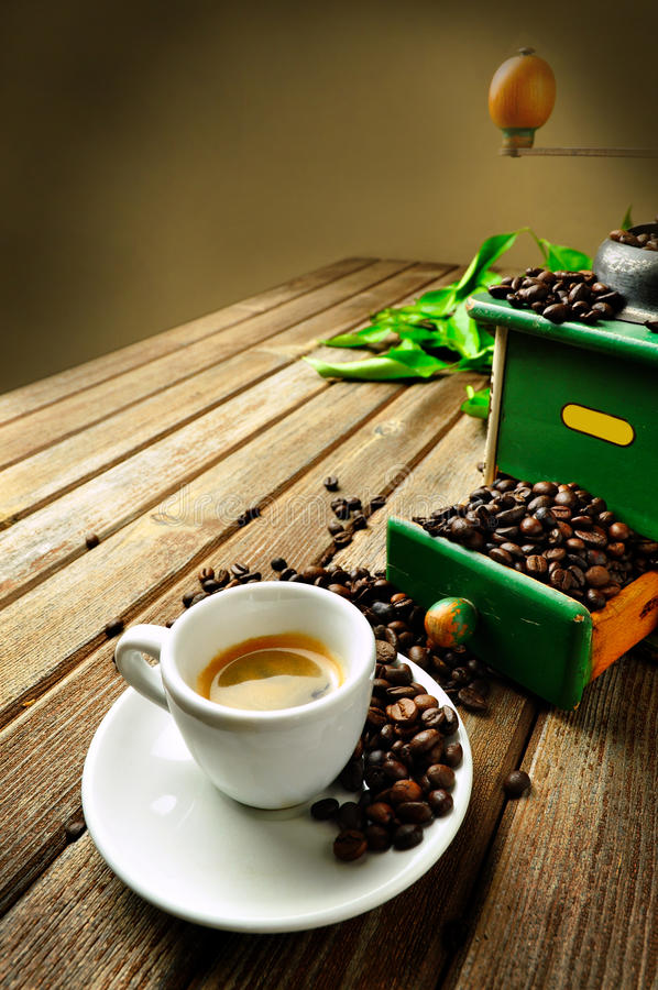 Cup of coffee. A hot cup of coffee with coffee-grinder royalty free stock photography