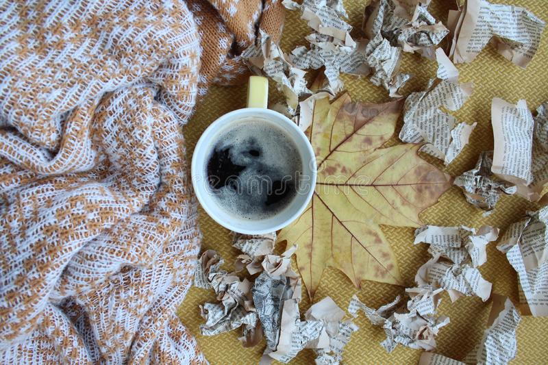 A cup of coffee and leaves stock images