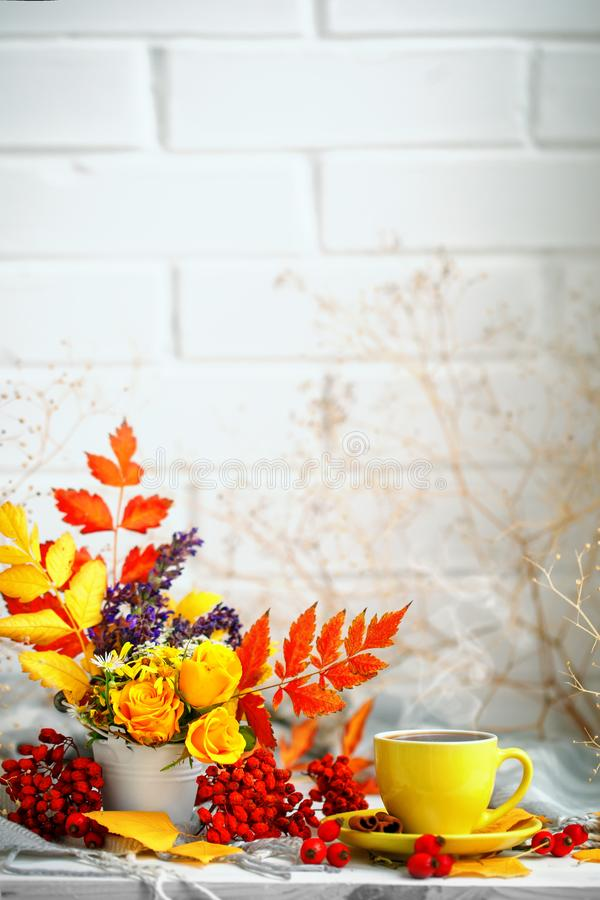Cup of coffee, autumn leaves and flowers on a wooden table. Autumn still life. Selective focus. royalty free stock photo