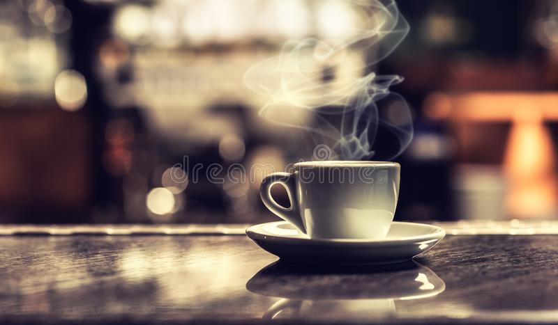 Cup of coffee on bar desk in night club.  stock photography