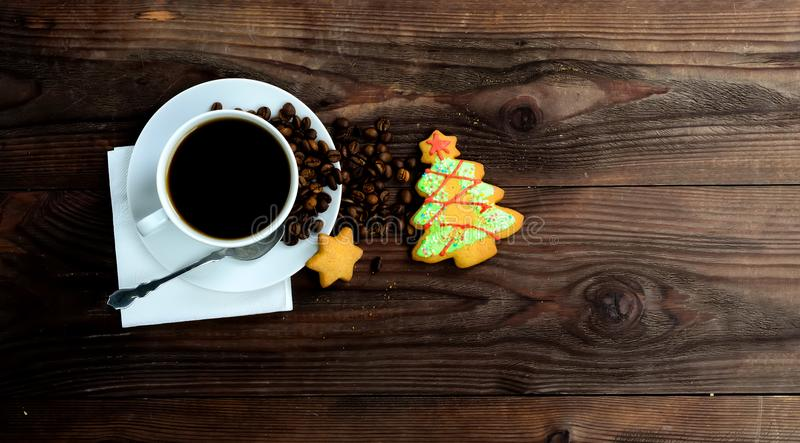 Cup of coffee ,coffee beans and biscuits for Christmas. On wooden background.Copy space for text.Top view,Flat lay royalty free stock image