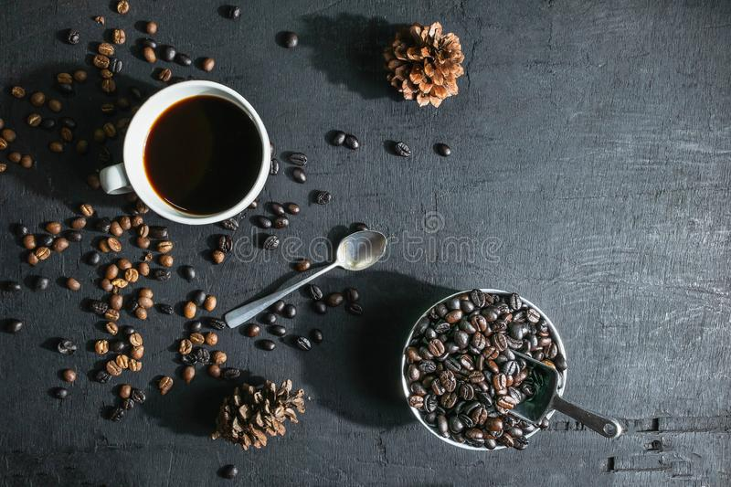.Cup of coffee and coffee beans On a black background royalty free stock photography