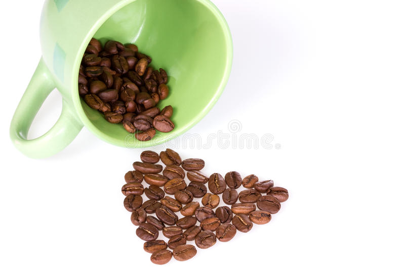 Cup and coffee beans heart royalty free stock photo