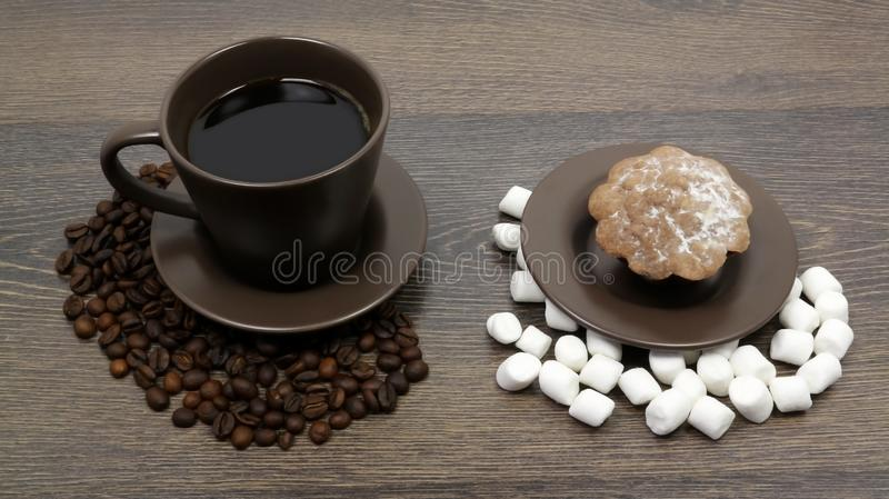 Cup of coffee with beans and marshmallow on the wooden table, delicious dessert royalty free stock photos