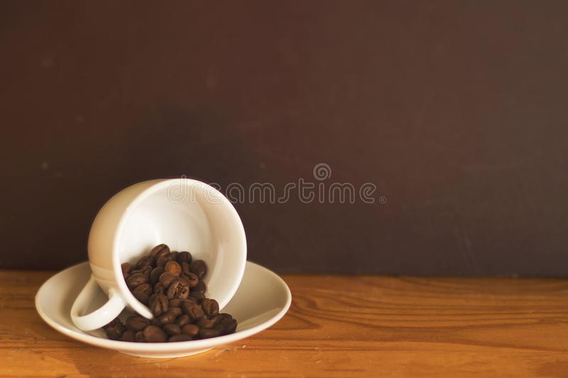 Cup with Coffee Beans royalty free stock photo