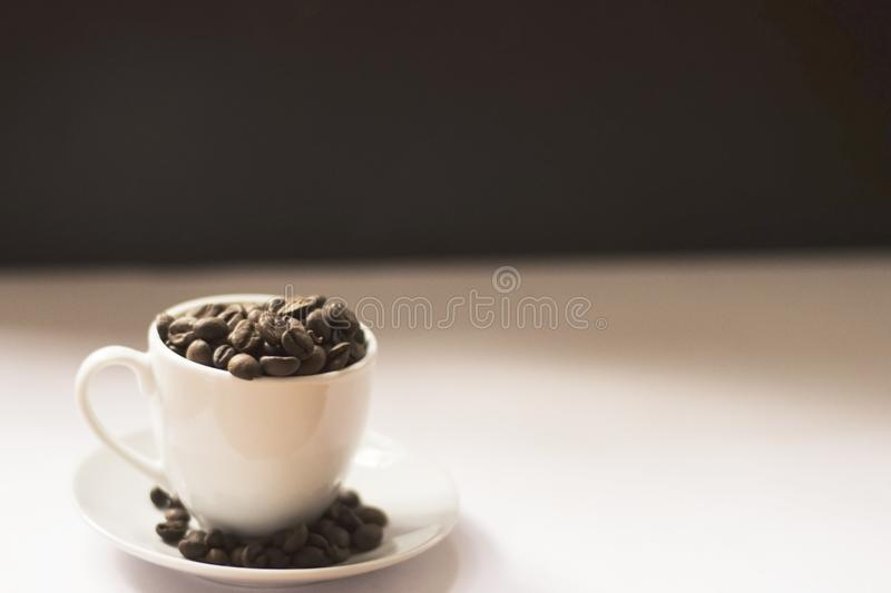 Cup with Coffee Beans 3 royalty free stock image