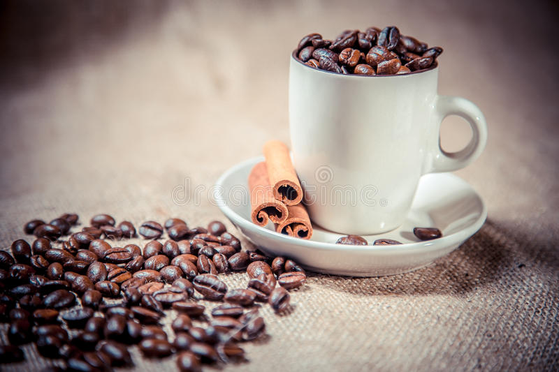 Cup of coffee beans on sackcloth royalty free stock photo