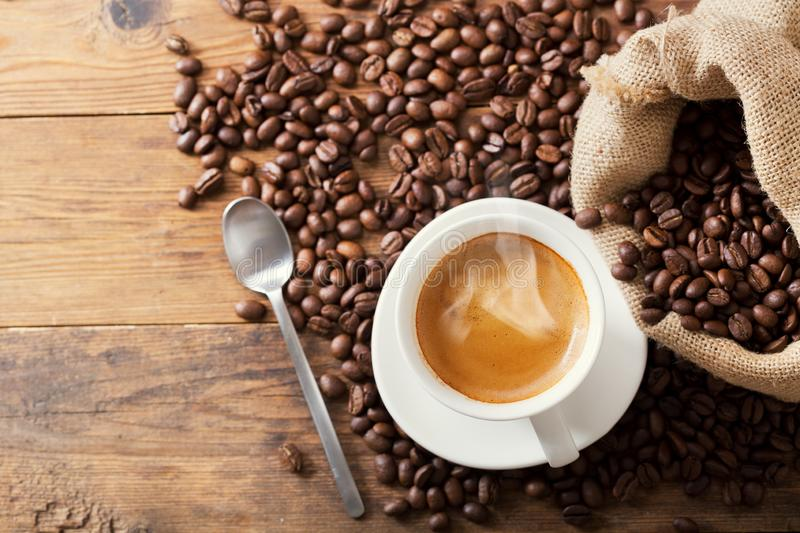 Cup of coffee and coffee beans, top view stock photos