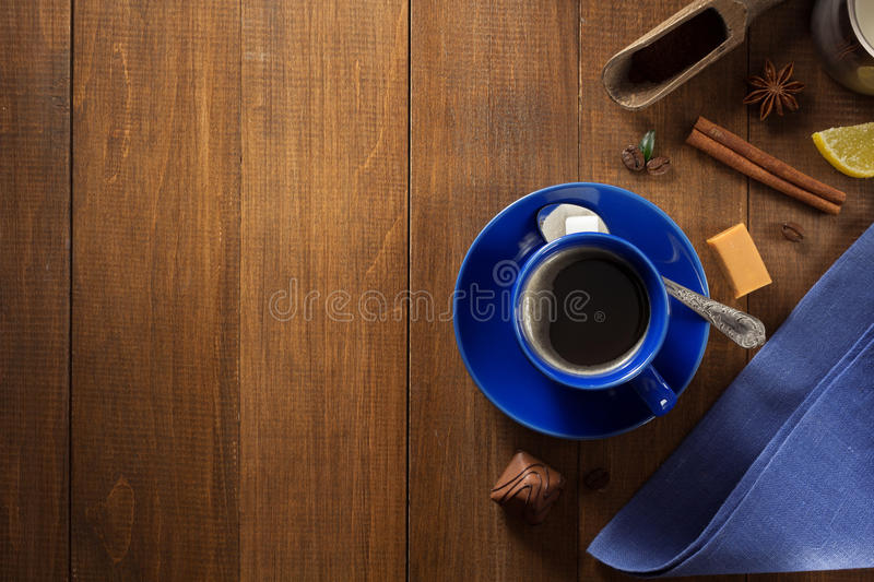 Cup of coffee and beans on wood stock photos