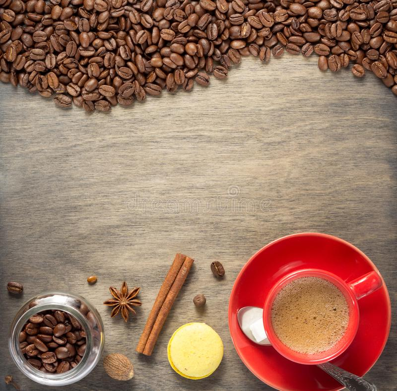 Cup of coffee and beans on wooden background stock photography