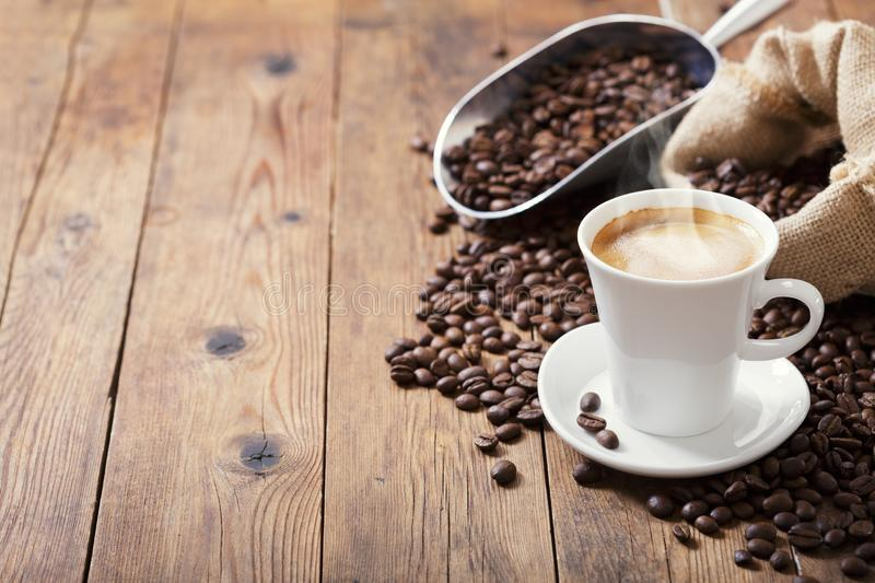 Cup of coffee and coffee beans stock photography