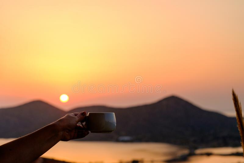 Cup of coffee on the beautiful backdrop mountains and sea royalty free stock images