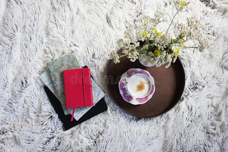 Cup of coffee in bed royalty free stock photos