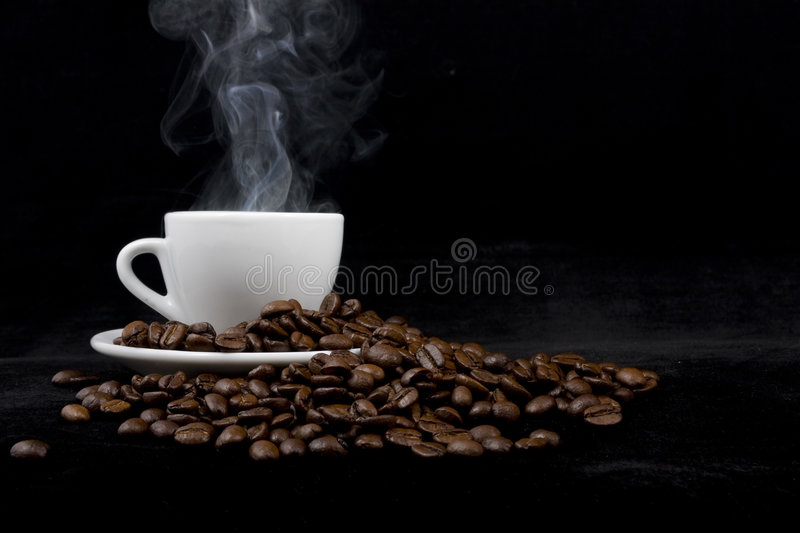 Cup of coffee on black royalty free stock photos