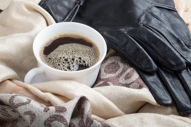 Download Cup Of Coffee And Black Leather Gloves Stock Photo - Image: 83717813