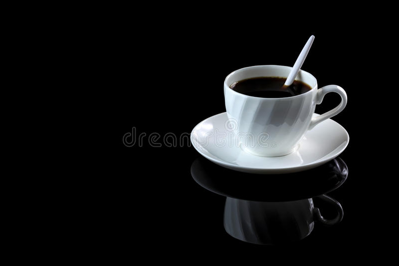 Cup of coffee on a black reflective background. Studio shot stock photo