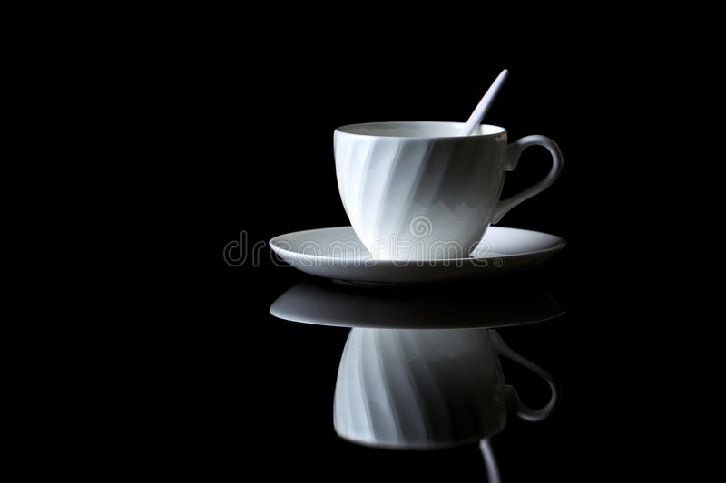 Cup of coffee on a black reflective background. Studio shot stock images