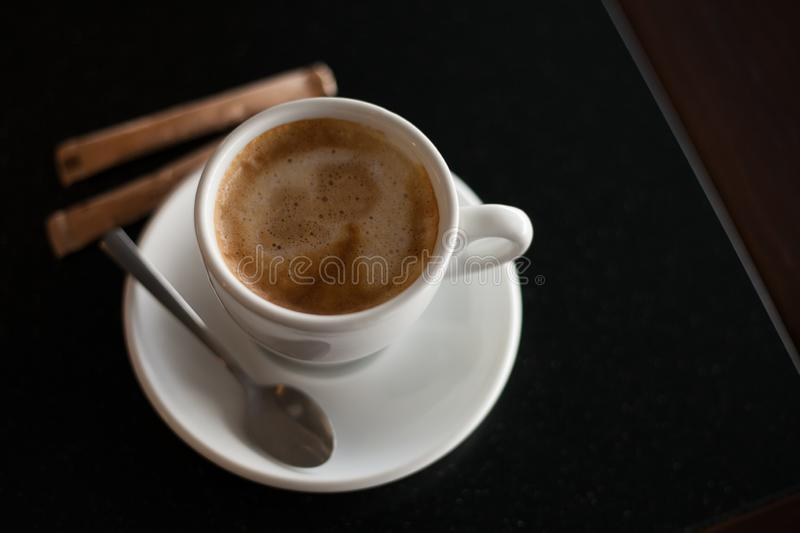 Cup of coffee on the black table. royalty free stock images