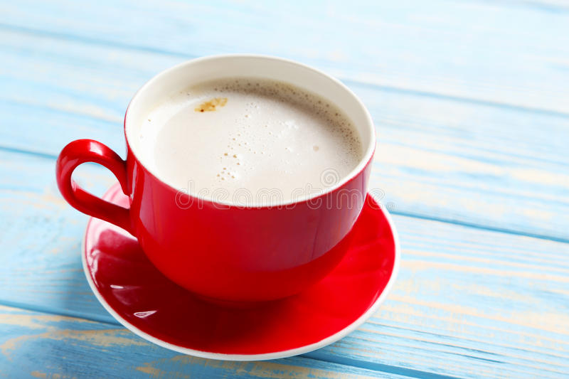 Cup of coffee. On a blue wooden table stock image