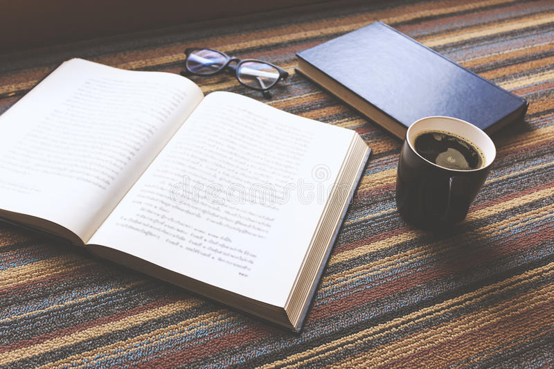 Cup of coffee and book royalty free stock image