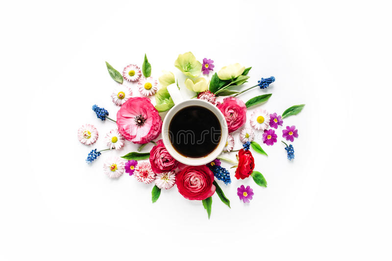 Cup of coffee and bouquet of flowers isolated on white background stock images