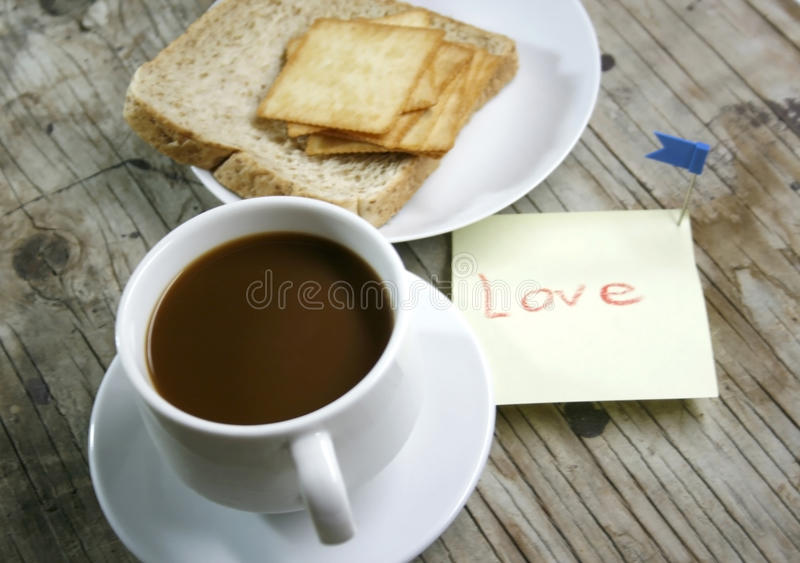 A cup of coffee and bread. Plate with a cup of coffee and bread royalty free stock photos