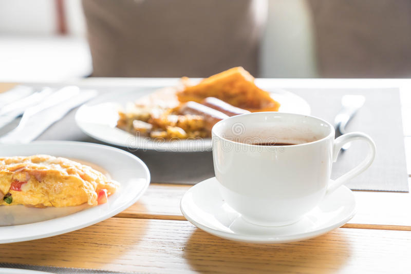 A cup of coffee for breakfast. A cup of coffee on table for breakfast stock photos