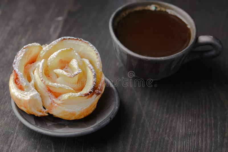 Biscuits with jam. Cup of coffee and a bun in the form of a rose,homemade buns with jam,homemade baking,puff pastries with a cup of coffee stock photos