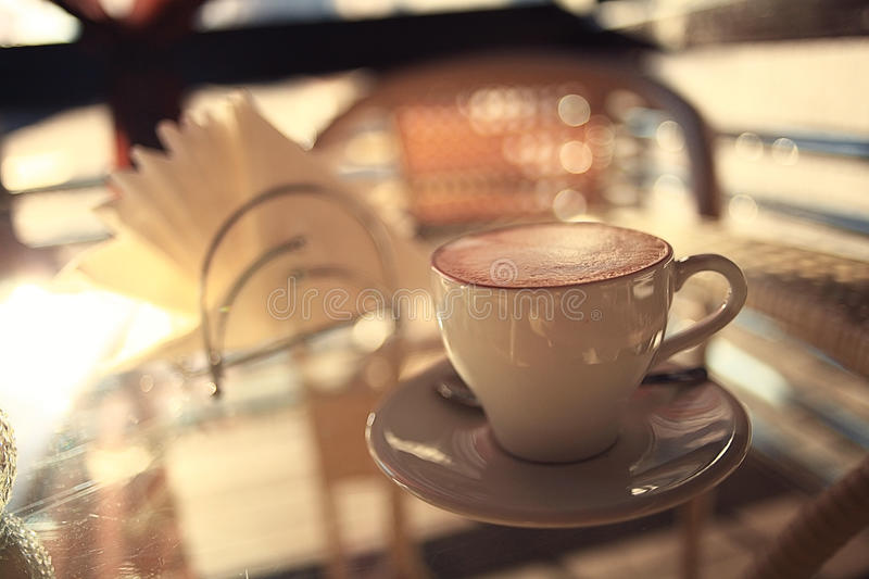 Cup of coffee at cafe table. Cup of coffee on cafe table stock photography