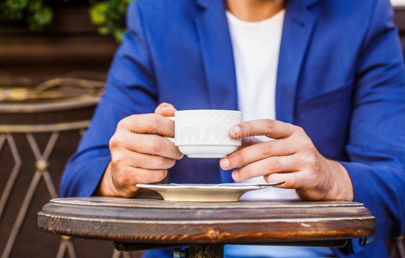 Cup of coffee. Cappuccino and black espresso coffe cup. Coffee drink. Close up of a man hands holding a hot coffe cups royalty free stock photos