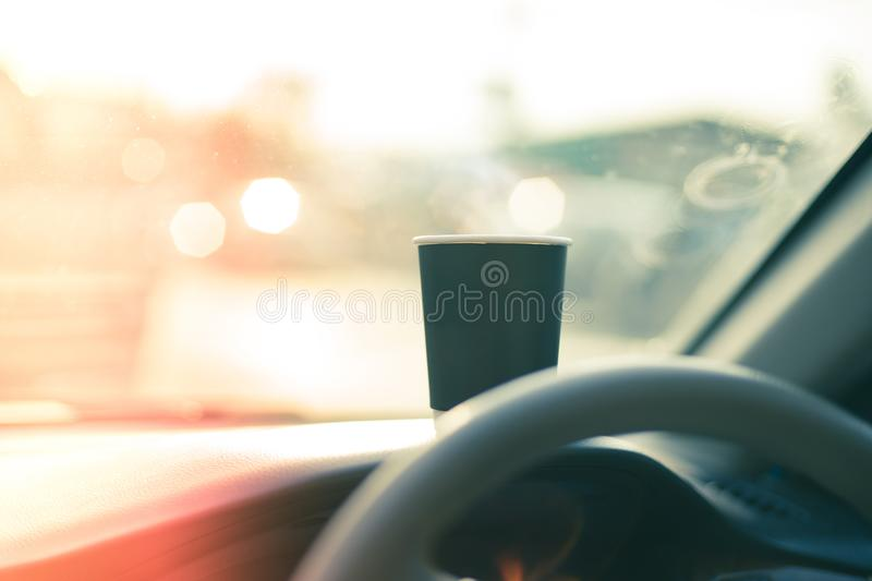 Cup of coffee on car console stock photo