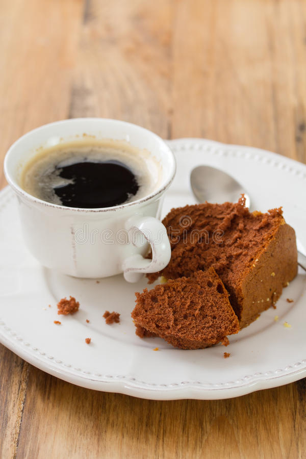 Cup of coffee with chocolate cake. And spoon royalty free stock images