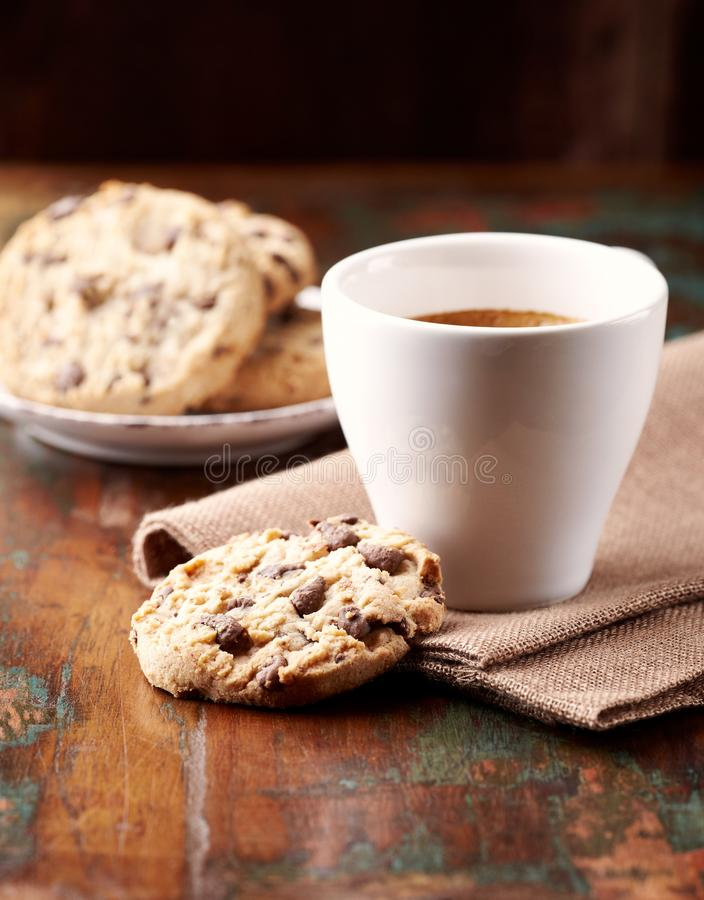 Cup of coffee and chocolate chip cookies. royalty free stock photo
