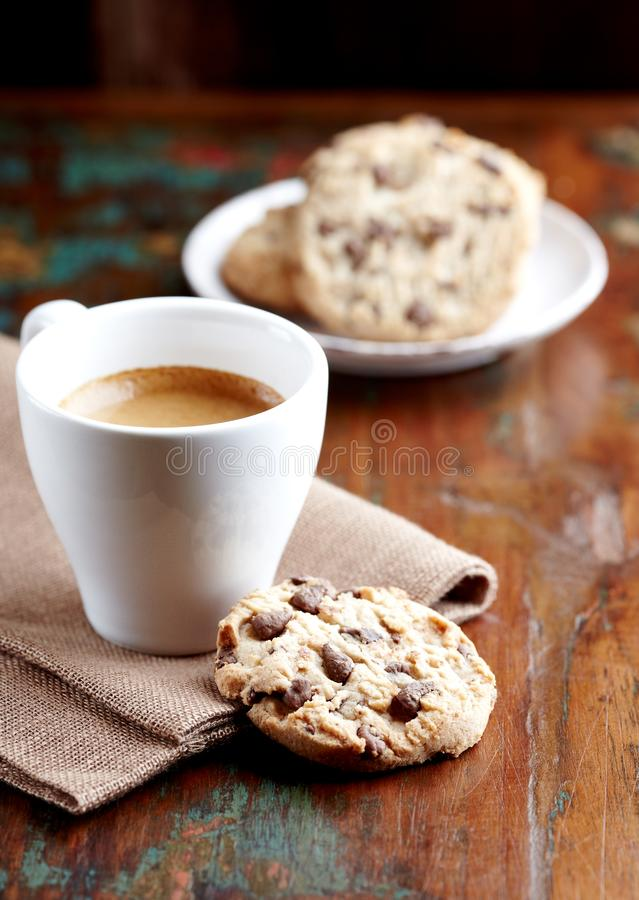 Cup of coffee and chocolate chip cookies. stock image