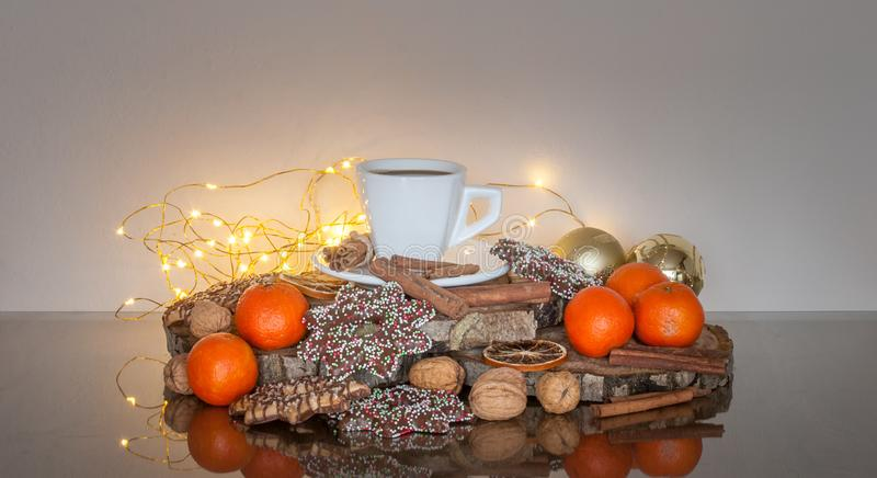 Cup of Coffee and Christmas Biscuits Composition. Cup of coffee and Christmas biscuit composition on the fairy lights background stock photo