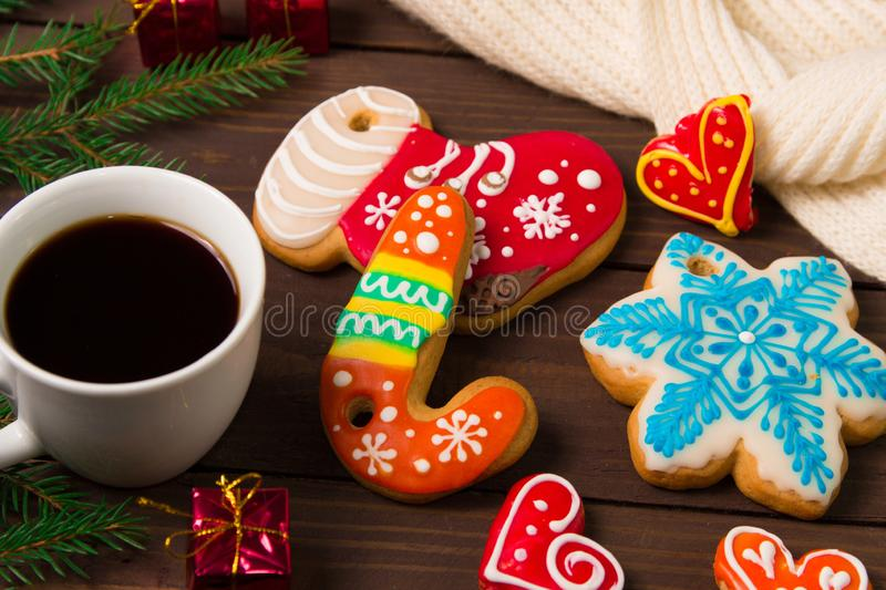 Cup of coffee and christmas cookies , gingerbread and toys on wooden table. Holiday drink breakfast xmas decoration morning white cafe year happy food new mug stock photos