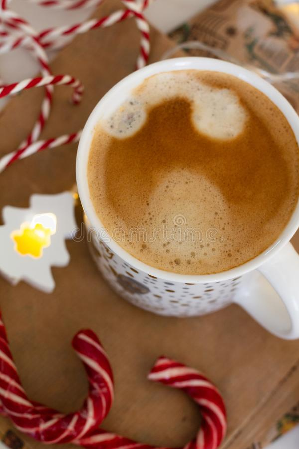 cup of coffee and christmas decoration top view close up royalty free stock photography