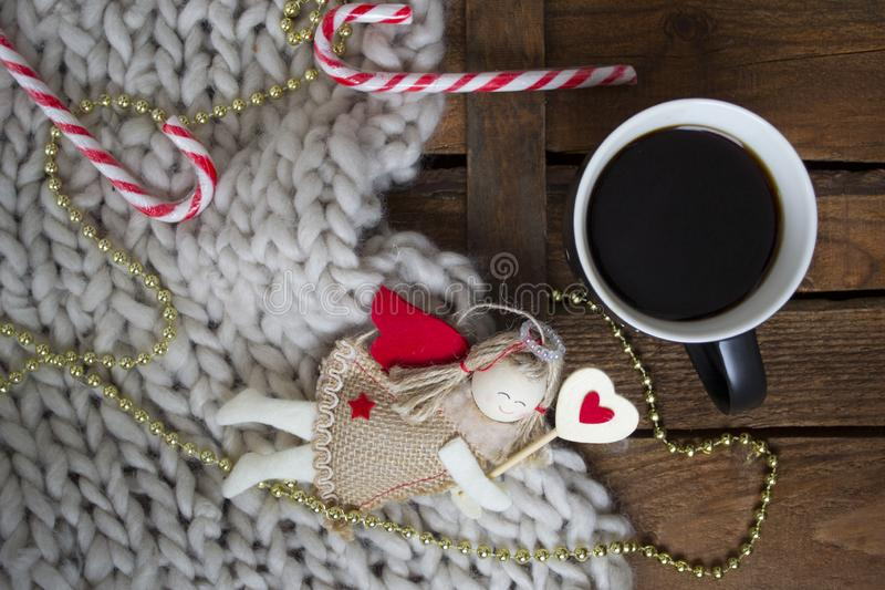Christmas coffee with lollipop. Cup with coffee and christmas decorations on wooden background. Christmas candy royalty free stock photo