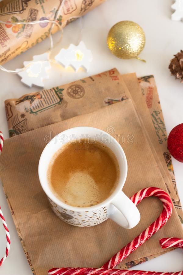 Cup of coffee and christmas garland close-up royalty free stock photos