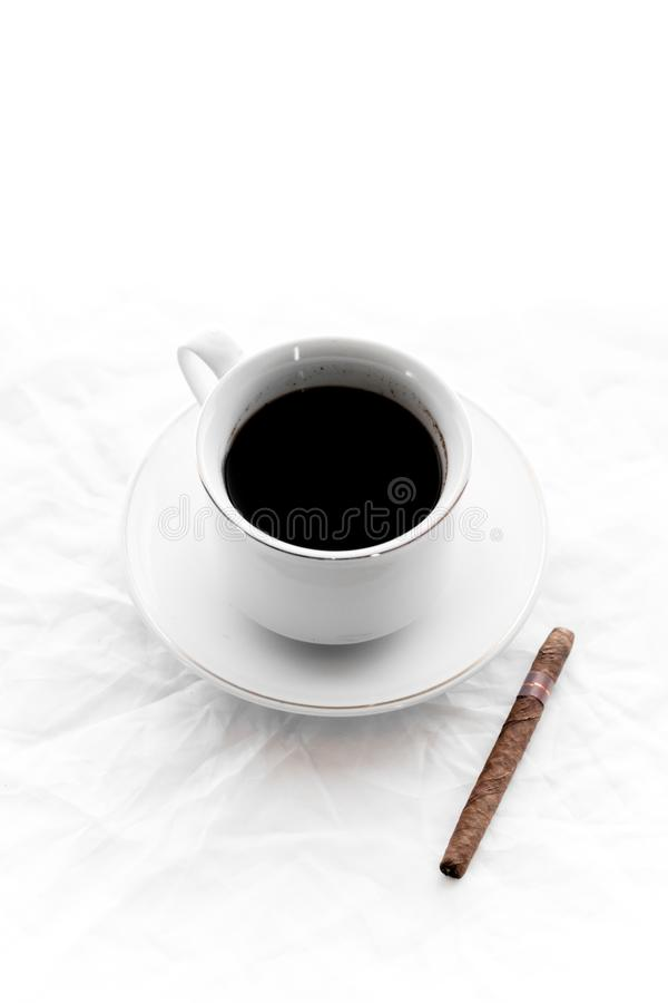 Coffee time. A cup of coffee and cigar stock photography