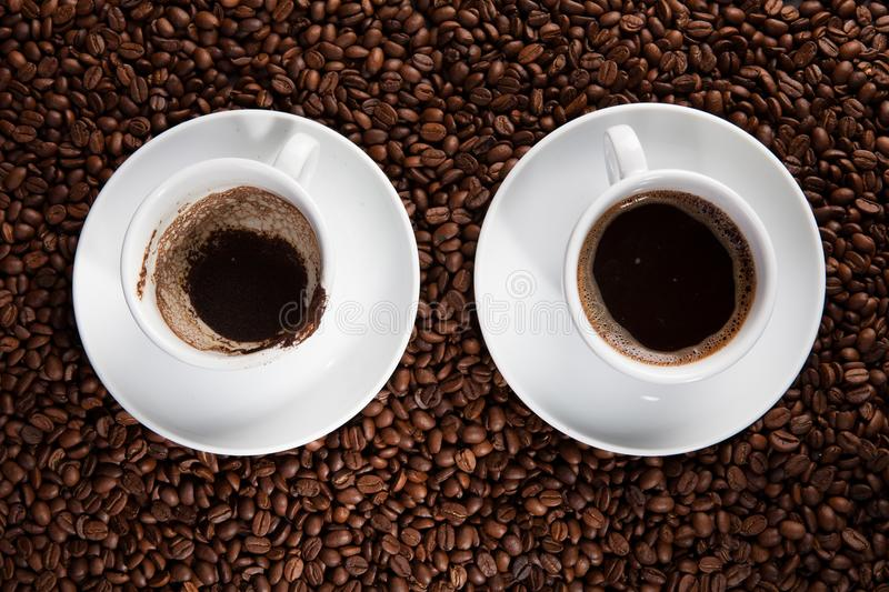 White cup of coffee at coffee beans backgrounds stock photos