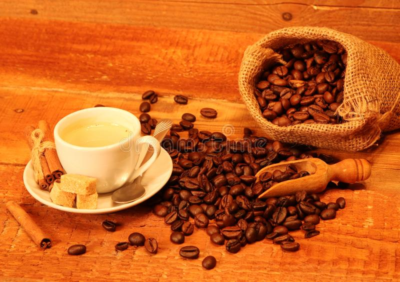 Cup of coffee with coffee beans, burlap sack, bag royalty free stock images