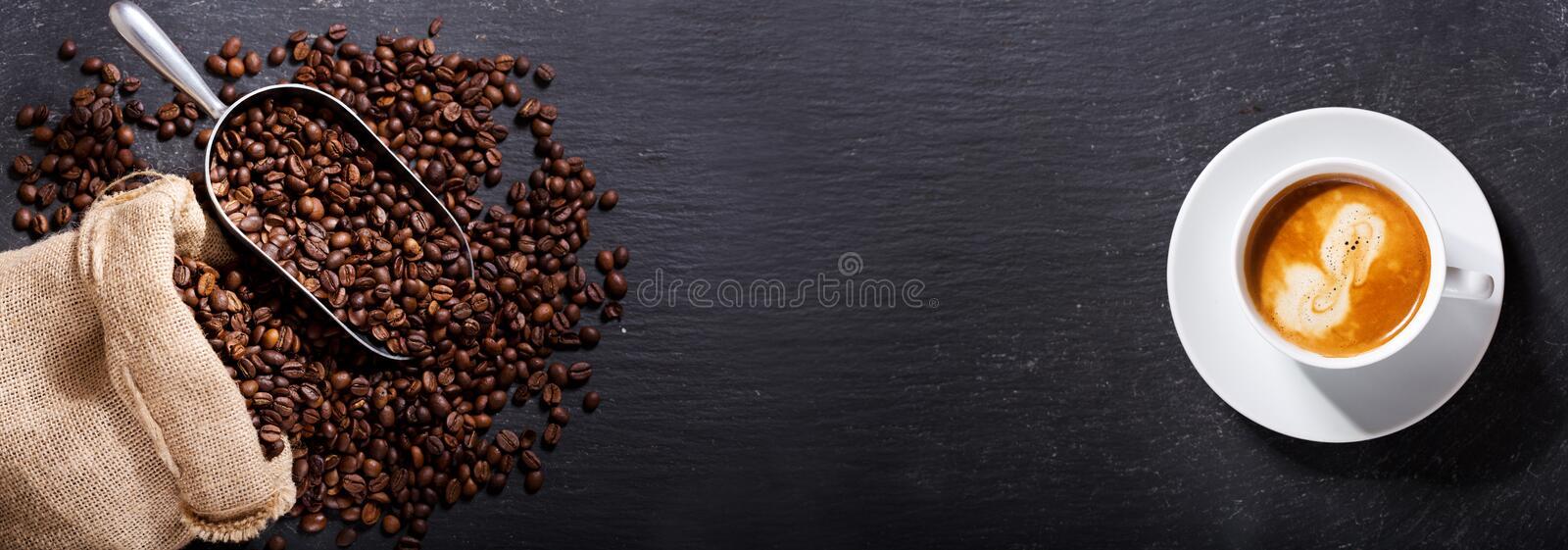 Cup of coffee and coffee beans in a sack, top view royalty free stock photo