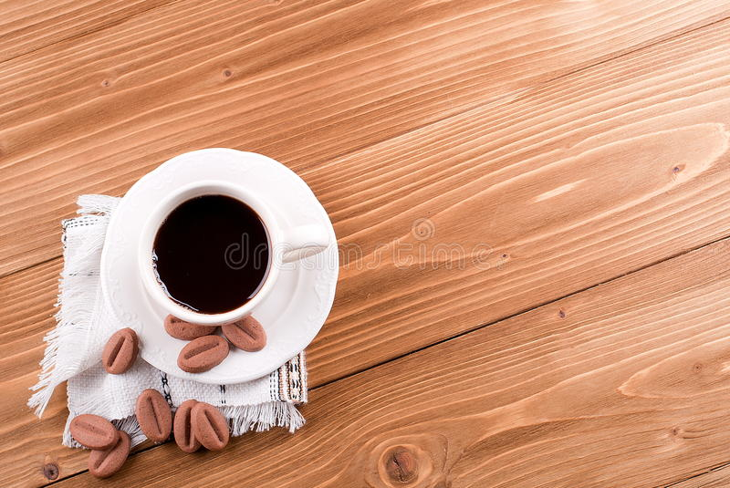 Cup of coffee with coffee biscuits stock image