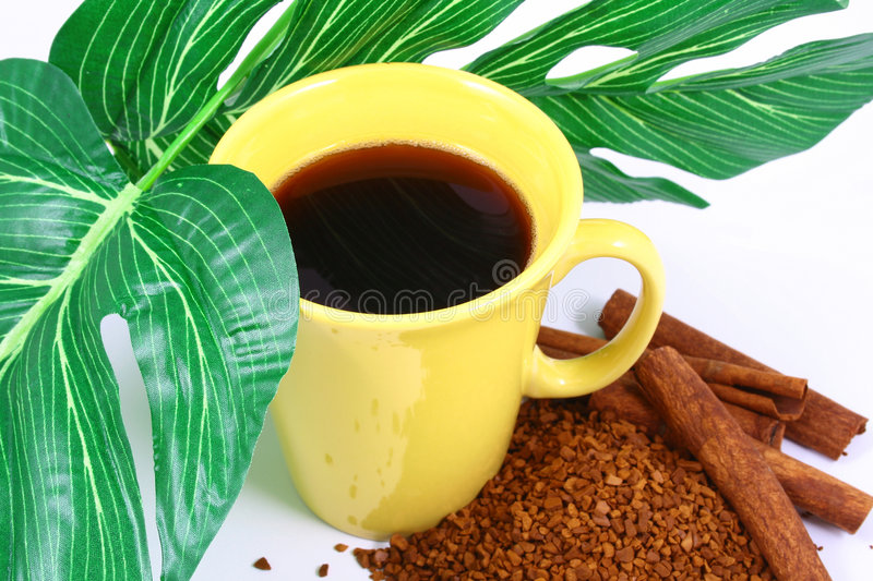 Cup of coffee with coffee grai royalty free stock photos