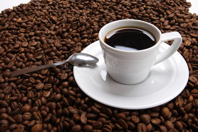 Cup coffee And coffee grain. Cup with coffee, costing on coffee grain stock image