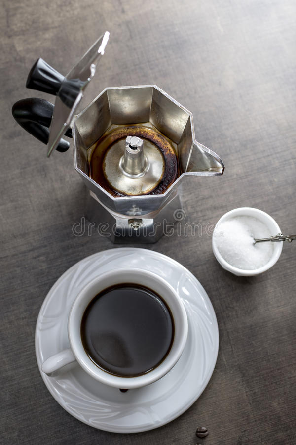 Cup of coffee with coffee maker stock photography